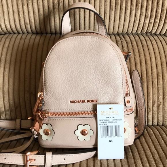 ca2b6dd9266c Authentic Michael Kors xs rhea zip backpack